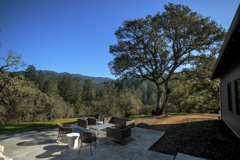 From the back of the house, the view extends high into the Mayacamas Mountains, where the soft sage greens of valley oaks are highlighted against the taller evergreens that rise in teh background. 9Chris Hardy