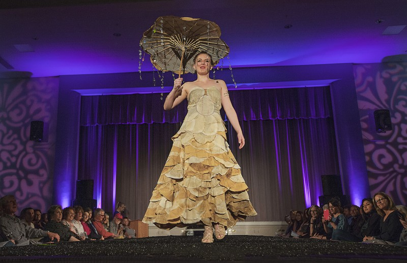 "Eden Pieper modeled Susan Heeringa-Pieper's design ""Caffeine Couture,' made from used coffee filters and aluminum pop tops, at the Sonoma Community Center's Trashion Fashion Show last Saturday, March 19. High couture made from lowly rubbish graced the catwalk at the Vets Building for an appreciative crowd. (Photos by Robbi Pengelly"