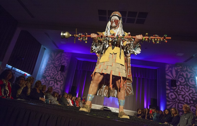 "Robert Stickley, who took first prize, modeled his own design - ""Remodel Shaman,"" made from security window envelopes, beer bottle caps, and miscellaneous construction-site detritus - at the Sonoma Community Center's Trashion Fashion Show last Saturday, March 19. High couture made from lowly rubbish graced the catwalk at the Vets Building before an appreciative crowd. (Photos by Robbi Pengelly"