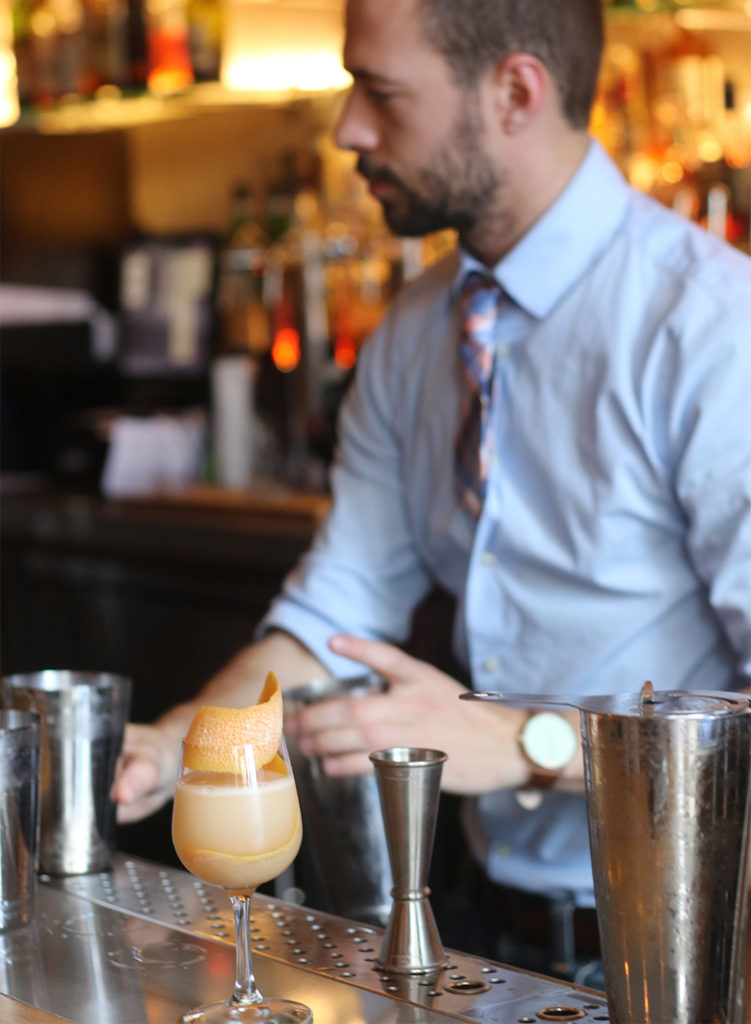 Bartender making a seasonal cocktail with grapefruit at County Bench Restaurant in Santa Rosa, Heather Irwin/PD