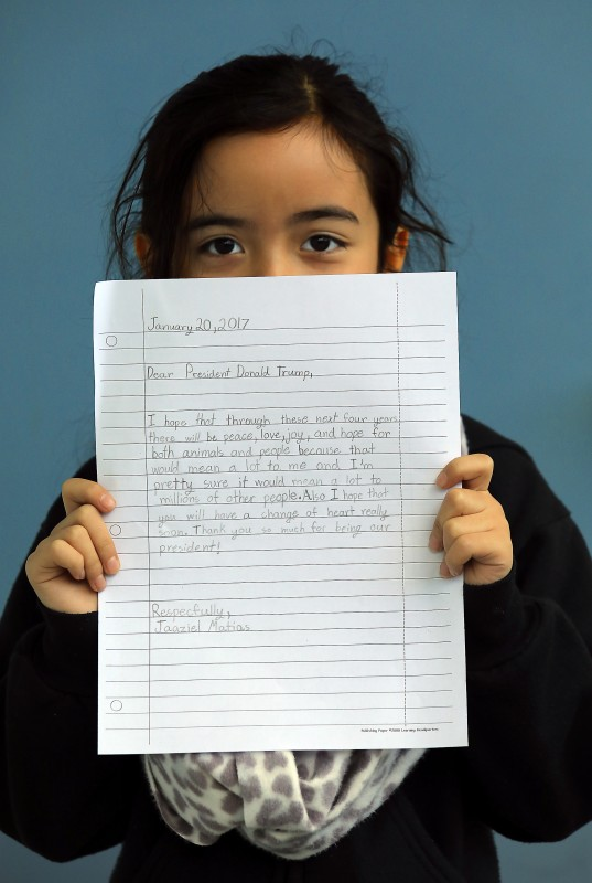 Cali Calmécac Language Academy third-grader Jaaziel Matias, 8, holds a letter she wrote to President Donald Trump on Inauguration Day. (John Burgess)
