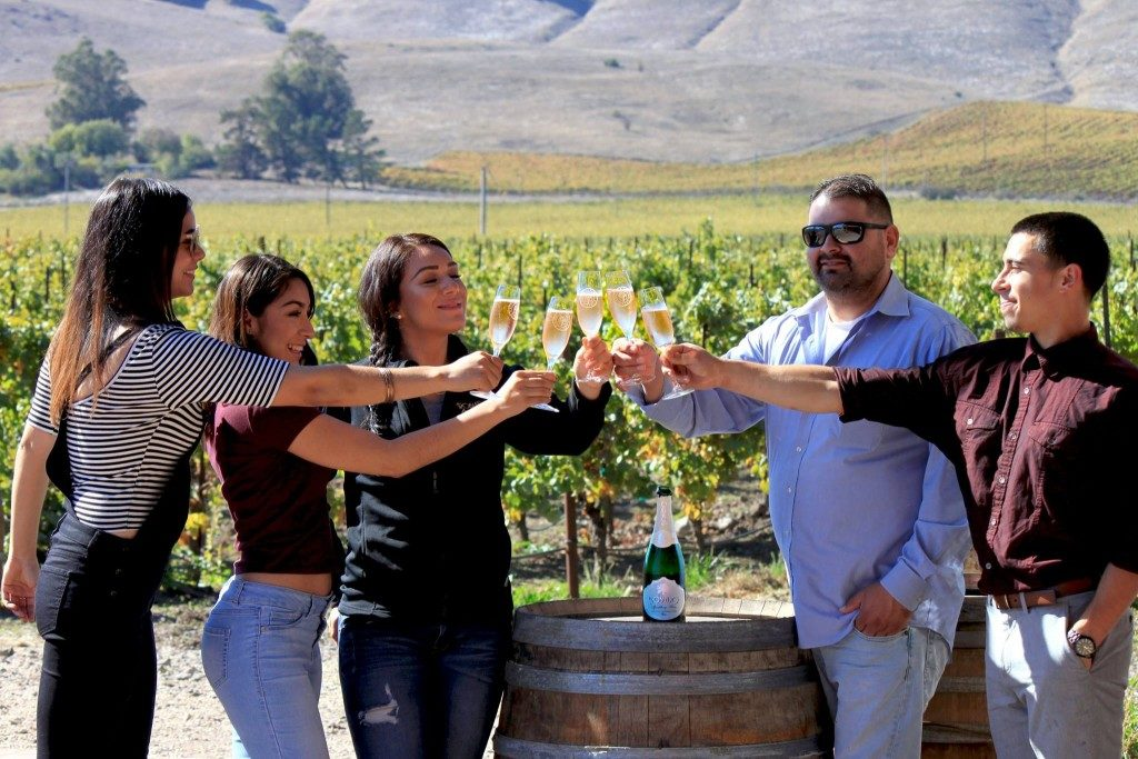 People toast with sparkling wine at Robledo Family Winery in Sonoma, California