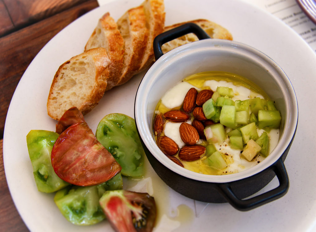Warm burrata with heirloom tomato, sauce vierge and bread at Russian River Vineyards in Forestveille. Heather Irwin/PD
