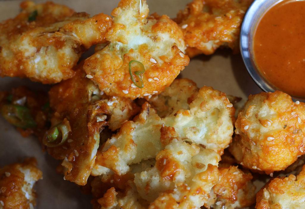 "Crispy cauliflower ""wings"" with Sriracha sauce at Chicken Pharm restaurant in Petaluma. Heather Irwin/PD"