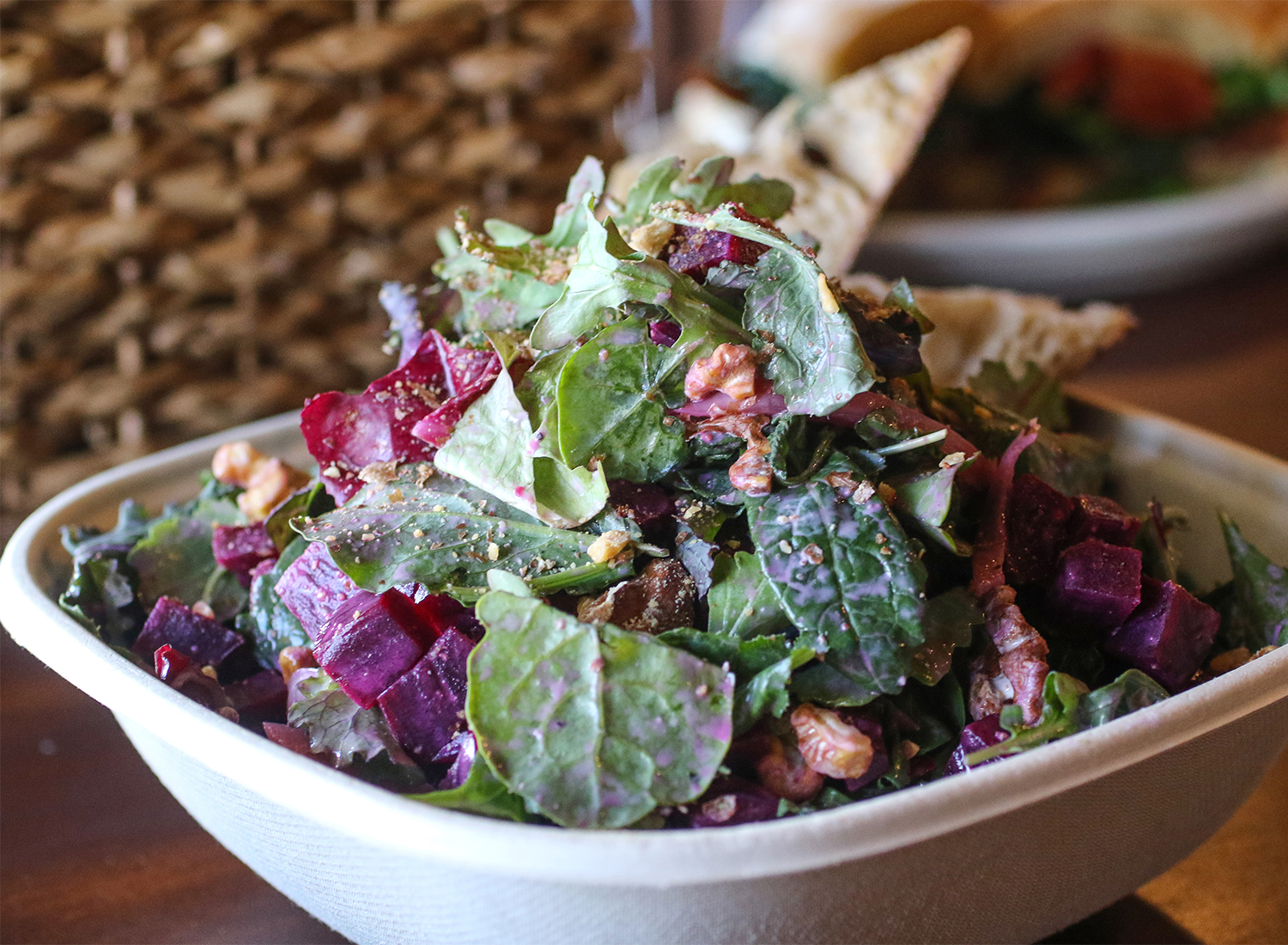 Beets and greens salad with walnuts, pickled onions, black pepper buttermilk dressing. Heather Irwin/PD