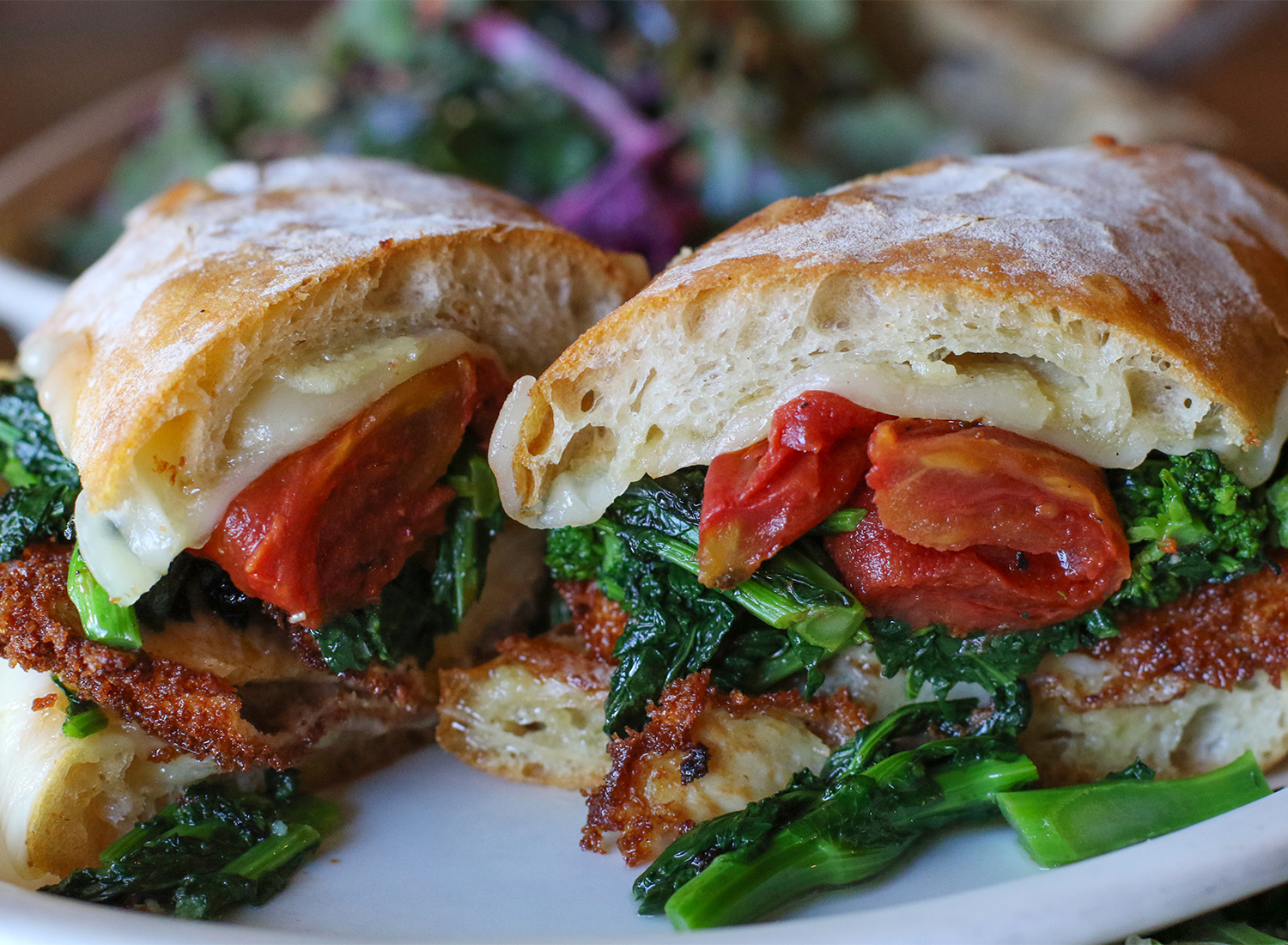 Philly sandwich with fried chicken breast, provolone, oven roasted tomatoes and broccoli rable. Heather Irwin/PD