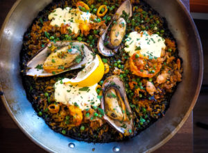 El Pescador paella with sea clams, mussels, prawns, squid, sweet peas, arroz negro, peppers and aioli at Gerards Paella Y Tapas in Santa Rosa. Heather Irwin/PD