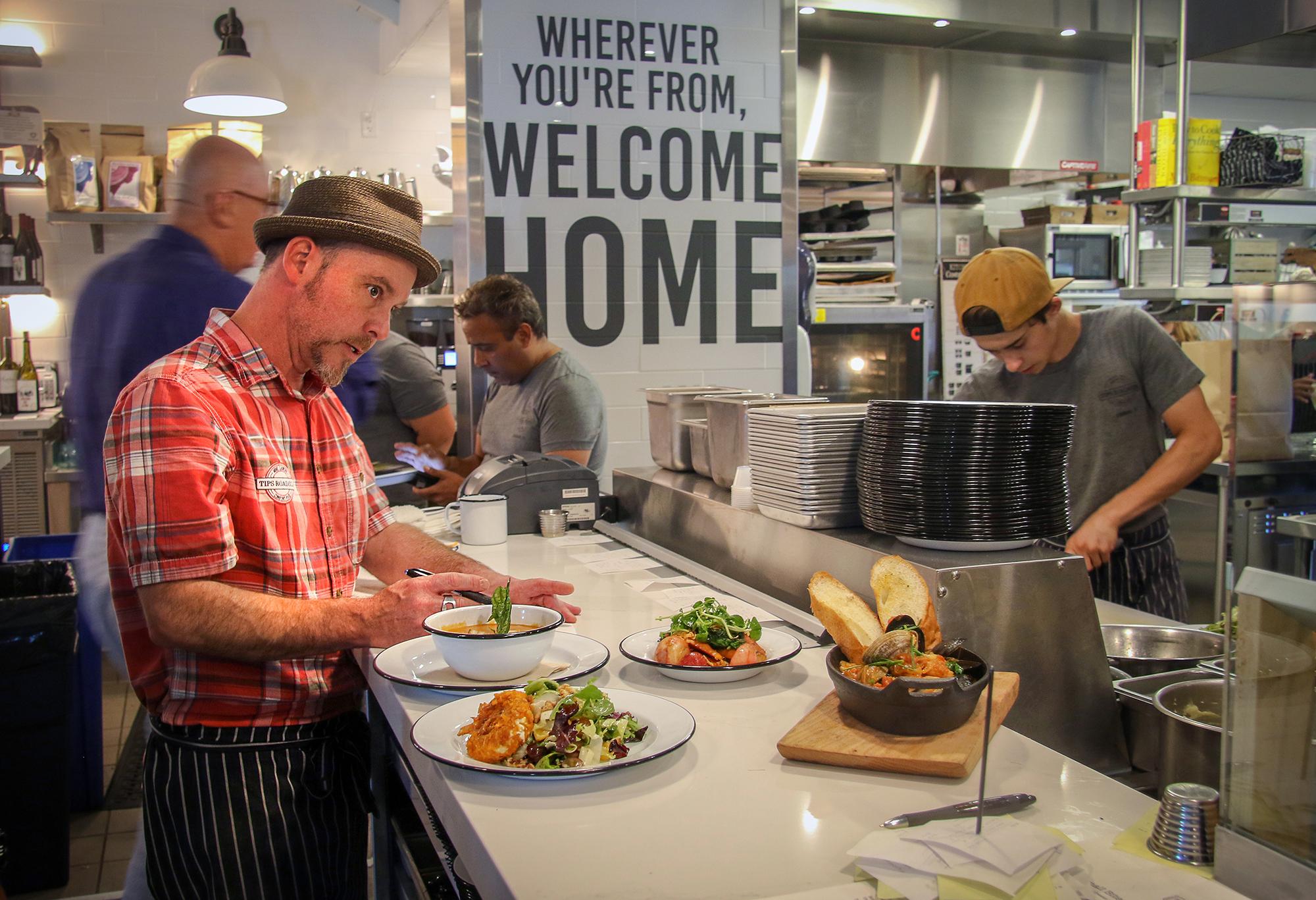 Chef Thaddeus Palmese expedites service at Tips Roadshouse in Kenwood. Heather Irwin, PD