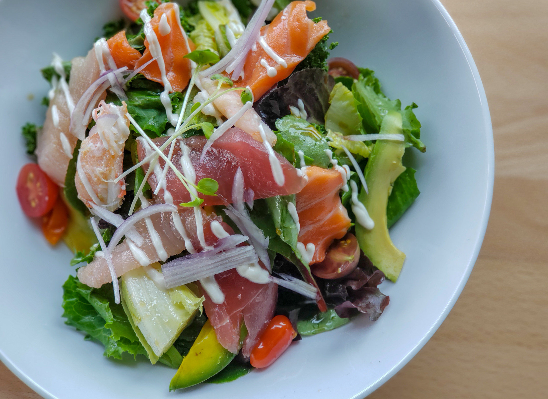 Sashimi salad with tuna, salmon, crab at Raku Ramen and Rolls in Santa Rosa. Heather Irwin/PD