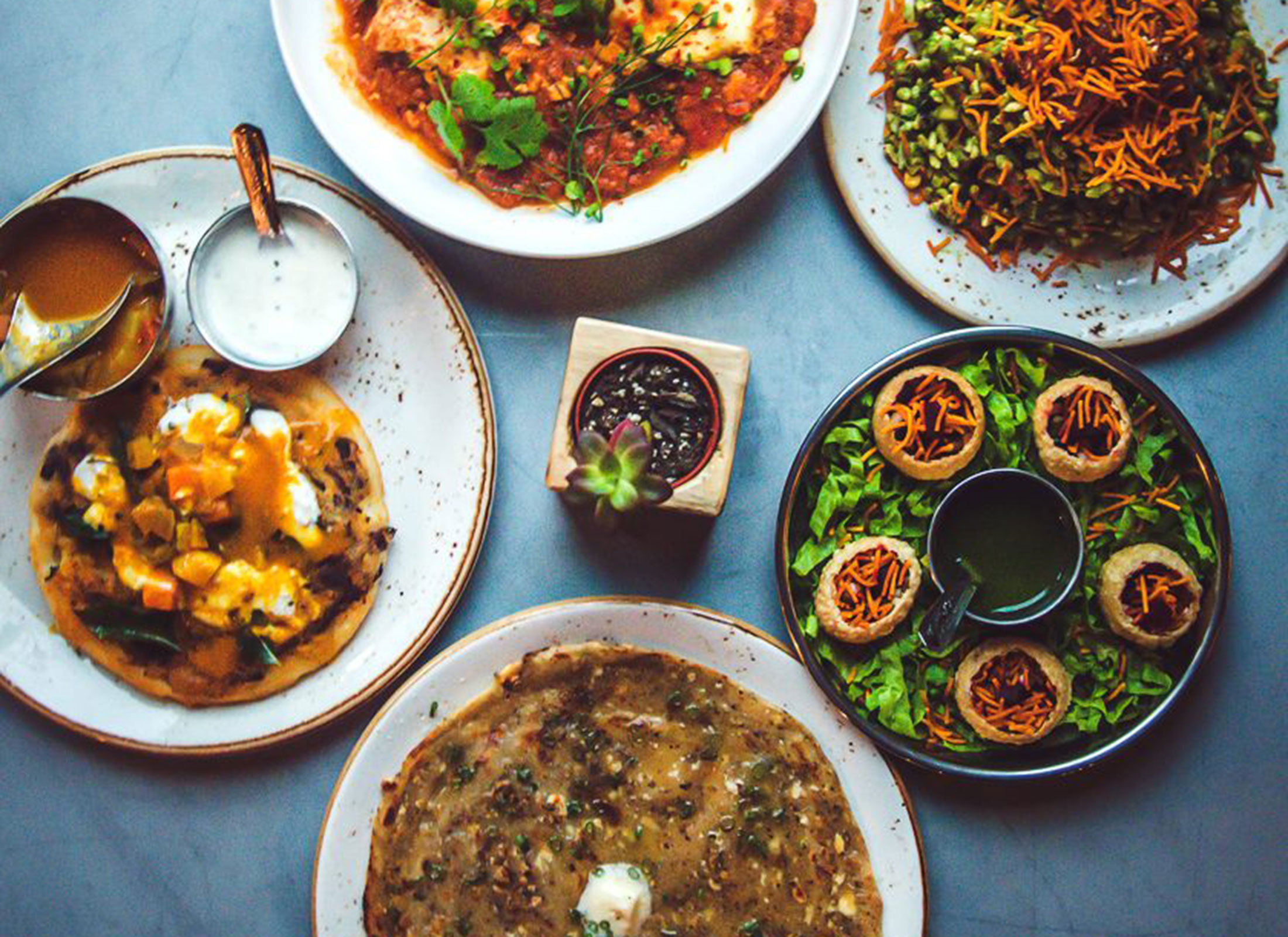 Garlic naan, pani puri, uttapam, tikka masala at Bollywood Bar & Clay Oven. Courtesy photo: Facebook