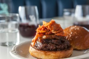 Burger with kimchi at Mint and Liberty in Sonoma. Courtesy photo.