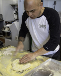 Alastair shows how he works the dough at Acre Pizza in Sebastopol. Heather Irwin/PD