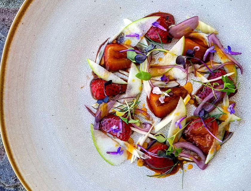 Pickled strawberry salad with green apple, pickled shallots, micro radish, passion fruit white balsamic and chili oil. Photo: Steve Roybal